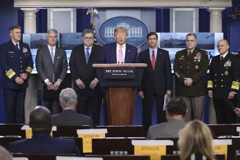 United States President Donald J. Trump speaks during a press conference in the Brady Press Briefing Room of the White House on April 1, 2020 in Washington, DC. Pictured behind the President, from left to right: Admiral Karl L. Schiltz, Commandant of the US Coast Guard; United States National Security Advisor Robert C. O