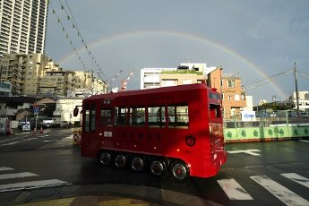An electric bus gores as a rainbow appears in the sky in Tokyo, Japan August 13, 2020. (Photo by AFLO