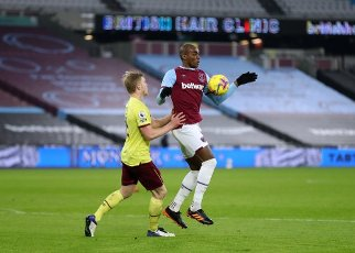 16th January 2021; London Stadium, London, England; English Premier League Football, West Ham United versus Burnley; Ben Mee of Burnley challenges Angelo Ogbonna of West Ham United