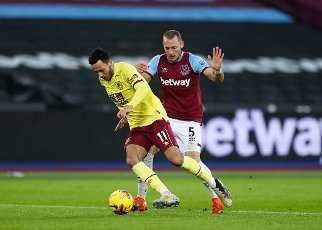 16th January 2021; London Stadium, London, England; English Premier League Football, West Ham United versus Burnley; Dwight McNeil of Burnley challenges Vladimír Coufal of West Ham United