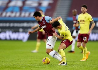 16th January 2021; London Stadium, London, England; English Premier League Football, West Ham United versus Burnley; Ashley Westwood of Burnley challenges Pablo Fornals of West Ham