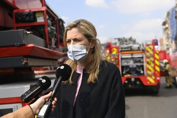 Interior Minister Annelies Verlinden pictured during a visit of interior minister Verlinden to the site of a fire in a house with flats, in Anderlecht, Brussels, Monday 19 April 2021. 24 people were sent to hospital, including some fire fighters. One person was killed in the fire. The fire is still active as it has transferred to an industrial warehouse stocking paper. BELGA PHOTO LAURIE DIEFFEMBACQ