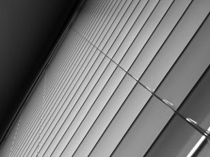 Low angle view of Venetian curtains abstract background and texture in black and white. No people. Copy space