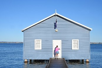 Australian girl visiting at the Blue Boat House in Perth Western Australia