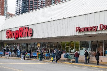 April 10, 2020: An overall view of shoppers waiting on line at The Shoprite supermarket in Jersey City after Governor Phil Murphy of The State of New Jersey tightened shopping restrictions on stores in Jersey City, New Jersey. Mandatory credit: Kostas Lymperopoulos/