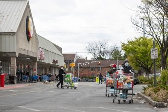 April 10, 2020: Shoppers walk with full carts at The Shoprite supermarket in Jersey City after Governor Phil Murphy of The State of New Jersey tightened shopping restrictions on stores in Jersey City, New Jersey. Mandatory credit: Kostas Lymperopoulos/