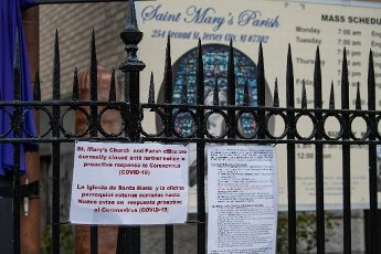 April 10, 2020: St. Mary of the Immaculate Conception Roman Catholic Church has a notice stating that they are closed for all services on Good Friday in Jersey City, New Jersey. Mandatory credit: Kostas Lymperopoulos/