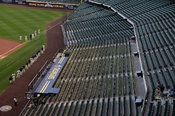 August 11, 2020: Brewers stand in front of dugout for National Anthem before the Major League Baseball game between the Milwaukee Brewers and the Minnesota Twins at Miller Park in Milwaukee, WI. John Fisher