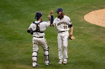 August 11, 2020: Milwaukee Brewers relief pitcher Josh Hader #71 and Milwaukee Brewers catcher Manny Pina #9 celebrate a victory during the Major League Baseball game between the Milwaukee Brewers and the Minnesota Twins at Miller Park in Milwaukee, WI. John Fisher
