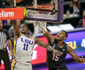 January 16, 2021: LSU\'s Josh LeBlanc Sr. (11) gets the ball up for a shot past South Carolina\'s Wildens Leveque (15) during NCAA Basketball action between the South Carolina Gamecocks and the LSU Tigers at the Pete Maravich Assembly Center in Baton Rouge, LA. Jonathan Mailhes