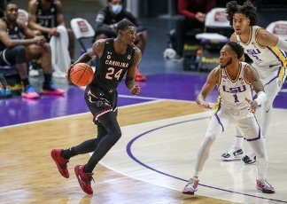 January 16, 2021: South Carolina\'s Keyshawn Bryant (24) looks for an open lane past LSU\'s Javonte Smart (1) and Trendon Watford (2) during NCAA Basketball action between the South Carolina Gamecocks and the LSU Tigers at the Pete Maravich Assembly Center in Baton Rouge, LA. Jonathan Mailhes