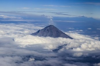 Aerial view of the PopocatÃpetl, an active volcano. Far in the distance the Pico de Orizaba, a stratovolcano, the highest mountain in