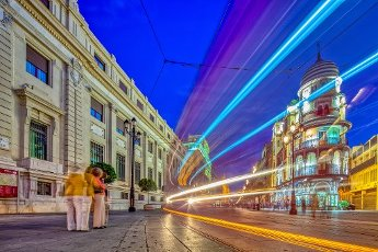 Light trails of a streetcar on Constitution Avenue, Seville