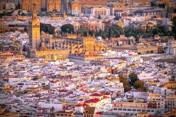 Aerial view of Seville downtown, with the Giralda tower, the Cathedral and the Archivo de Indias building, among other landmarks, Spain