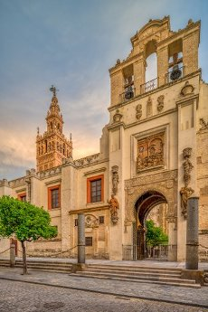 Puerta del Pedon (Door of Forgiveness) with the Giralda tower on the background, Seville