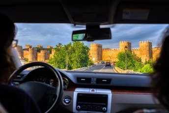 The medieval walls of Avila from a moving car