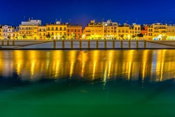 Betis street by the Guadalquivir river at night, Seville, Spain