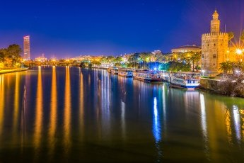 The Guadalquivir river and the Gold Tower (12th century) at night, Seville