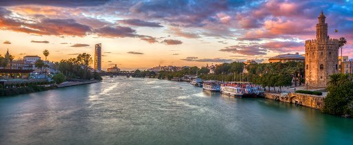 Panoramic view of the Guadalquivir River at dusk from San Telmo Bridge, Seville