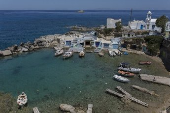 14 May 2021, Greece, Mandrakia: Boats are moored in the harbour bay of Mandrakia on the Greek island of Milos. Saturday, May 15, marks the official start of the 2021 tourism season in Greece, when most of the previous Corona restrictions will be lifted, including the travel ban within the country. Tourism is an important economic factor for the country. Photo: Socrates Baltagiannis\/dpa