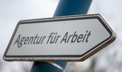 "06 May 2021, Saxony-Anhalt, Sangerhausen: ""Agentur für Arbeit"" is written on a signpost in front of the authority in Sangerhausen. Photo: Hendrik Schmidt\/dpa-Zentralbild\/ZB"
