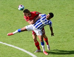 15 May 2021, Berlin: Football: Bundesliga, Hertha BSC - 1. FC Köln, 33. matchday at Olympiastadion. Cologne\'s Sebastiaan Bornauw (l) and Hertha\'s Jessic Ngankam fight for the ball. IMPORTANT NOTE: In accordance with the regulations of the DFL Deutsche Fußball Liga and the DFB Deutscher Fußball-Bund, it is prohibited to use or have used photographs taken in the stadium and\/or of the match in the form of sequence pictures and\/or video-like photo series. Photo: Soeren Stache\/dpa-Pool\/dpa