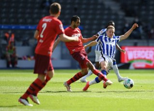 15 May 2021, Berlin: Football: Bundesliga, Hertha BSC - 1. FC Köln, Matchday 33 at the Olympiastadion. Cologne\'s Ellyes Skhiri and Hertha\'s Santiago Ascacibar (r) in action. IMPORTANT NOTE: In accordance with the regulations of the DFL Deutsche Fußball Liga and the DFB Deutscher Fußball-Bund, it is prohibited to use or have used photographs taken in the stadium and\/or of the match in the form of sequence pictures and\/or video-like photo series. Photo: Annegret Hilse\/Reuters-Pool\/dpa