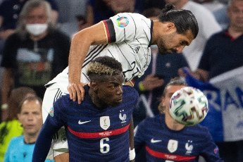 15 June 2021, Bavaria, Munich: Football: European Championship, France - Germany, preliminary round, Group F, 1st matchday in the EM Arena Munich. Germany\'s Emre Can (l) and France\'s Paul Pogba fight for the ball. Photo: Federico Gambarini\/dpa