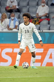 15 June 2021, Bavaria, Munich: Football: European Championship, France - Germany, preliminary round, Group F, 1st matchday in the EM Arena Munich. Germany\'s Leroy Sane plays the ball. Photo: Federico Gambarini\/dpa