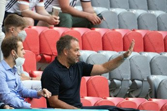 15 June 2021, Bavaria, Munich: Football: European Championship, France - Germany, preliminary round, Group F, 1st matchday in the EM Arena Munich. Germany\'s designated national coach, Hansi Flick, is sitting in the stadium. Photo: Federico Gambarini\/dpa