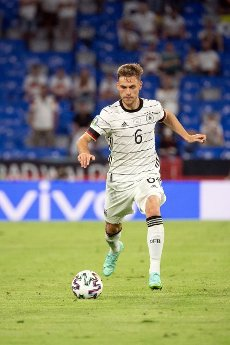 15 June 2021, Bavaria, Munich: Football: European Championship, France - Germany, preliminary round, Group F, 1st matchday in the EM Arena Munich. Germany\'s Joshua Kimmich plays the ball. Photo: Federico Gambarini\/dpa