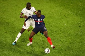 15 June 2021, Hamburg: Football: European Championship, France - Germany, preliminary round, Group F, 1st matchday in the EM Arena Munich. Antonio Rüdiger (Germany, l) and Paul Pogba (France) in action. Important: For editorial news reporting purposes only. Not used for commercial or marketing purposes without prior written approval of UEFA. Images must appear as still images and must not emulate match action video footage. Photographs published in online publications (whether via the Internet or otherwise) shall have an interval of at least 20 seconds between the posting. Photo: Christian Charisius\/dpa