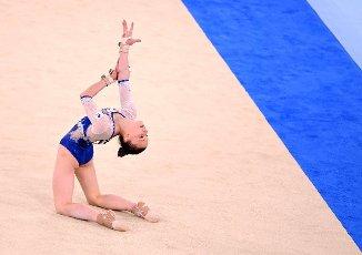 27 July 2021, Japan, Tokio: Gymnastics: Olympics, team, women, final, floor, at the Ariake Gymnastics Centre: Vladislava Urazova of the Russian Olymp. Committee in action Photo: Marijan Murat\/dpa