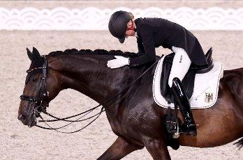 27 July 2021, Japan, Tokio: Equestrian Sport\/Dressage: Olympia, Team, Final, Equestrian Park. Jessica von Bredow-Werndl from Germany rides Dalera. The German dressage team wins gold. Photo: Friso Gentsch\/dpa