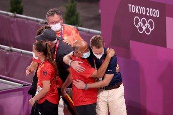 27 July 2021, Japan, Tokio: Equestrian sport\/dressage: Olympics, Team, Final, Equestrian Park. Coaches of the German team cheer. The German dressage team wins gold. Photo: Friso Gentsch\/dpa
