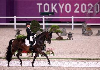 27 July 2021, Japan, Tokio: Equestrian Sport\/Dressage: Olympia, Team, Final, Equestrian Park. Jessica von Bredow-Werndl from Germany rides Dalera. Photo: Friso Gentsch\/dpa