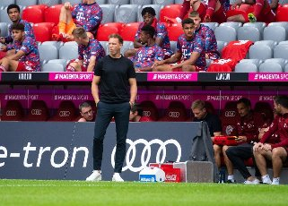 31 July 2021, Bavaria, Munich: Football: Test matches, FC Bayern Munich - SSC Napoli at Allianz Arena. Coach Julian Nagelsmann from Munich follows the match. Photo: Sven Hoppe\/dpa - IMPORTANT NOTE: In accordance with the regulations of the DFL Deutsche Fußball Liga and\/or the DFB Deutscher Fußball-Bund, it is prohibited to use or have used photographs taken in the stadium and\/or of the match in the form of sequence pictures and\/or video-like photo series