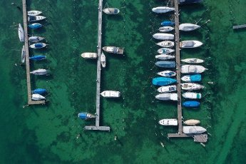 28 March 2020, Baden-Wuerttemberg, Konstanz: Sailing and motor boats are moored in the marina (aerial photo with drone). Only a few boats have sailed on Lake Constance during the day. Photo: Felix Kästle/