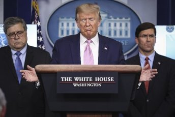United States President Donald J. Trump speaks during a press conference in the Brady Press Briefing Room of the White House on April 1, 2020 in Washington, DC. At Left is US Attorney General William P. Barr and at right is US Secretary of Defense Dr. Mark T. Esper. Credit: Oliver Contreras / Pool via CNP | usage