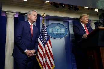 United States President Donald J. Trump speaks next to United States House Minority Leader Kevin McCarthy (Republican of California), left, at a press briefing on the COVID-19 pandemic with members of the Coronavirus Task Force at the White House in Washington on April 3, 2020. Credit: Yuri Gripas / Pool via CNP | usage