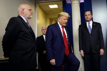 United States President Donald J. Trump, second right, arrives at a press briefing on the COVID-19 pandemic with members of the Coronavirus Task Force at the White House in Washington on April 3, 2020. Others pictured, from left to right: Director of the Centers for Disease Control and Prevention Dr. Robert Redfield; US Vice President Mike Pence; and US Secretary of Health and Human Services (HHS) Alex Azar. Credit: Yuri Gripas / Pool via CNP | usage