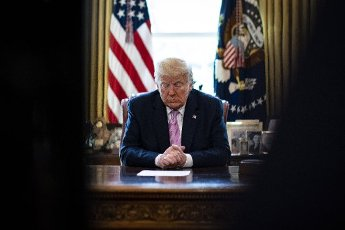 United States President Donald J. Trump bows his head during an Easter blessing by Bishop Harry Jackson, senior pastor at Hope Christian Church in Beltsville, Maryland, in the Oval Office of the White House on Friday, April 10, 2020 in Washington. Credit: Al Drago / Pool via CNP | usage