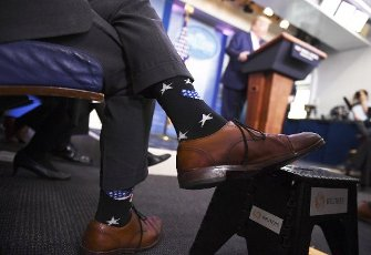 Director of the National Institute of Allergy and Infectious Diseases at the National Institutes of Health Dr. Anthony Fauci, wears star spangled socks as he listens to US President Donald J. Trump speak at a Coronavirus briefing at the White House on Friday, April 10, 2020, in Washington, DC. With the U.S. death toll from the coronavirus pandemic expected to peak over the weekend, most of the country will be firmly under stay-at-home orders on Easter Sunday. Credit: Kevin Dietsch / Pool via CNP | usage