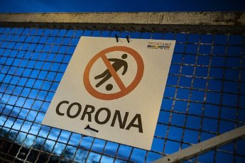 "10 April 2020, Hessen, Frankfurt/Main: A warning sign with the inscription ""Corona"" indicates a closed football field. Due to current restrictions, joint leisure activities in larger groups are also prohibited. Photo: Boris Roessler/"