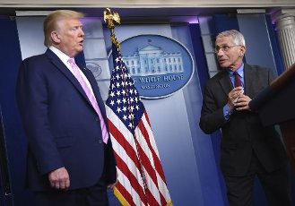 Director of the National Institute of Allergy and Infectious Diseases at the National Institutes of Health Dr. Anthony Fauci, speaks as United States President Donald J. Trump listens at a Coronavirus briefing at the White House on Friday, April 10, 2020, in Washington, DC. With the U.S. death toll from the coronavirus pandemic expected to peak over the weekend, most of the country will be firmly under stay-at-home orders on Easter Sunday. Credit: Kevin Dietsch / Pool via CNP | usage