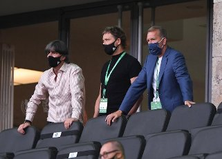 Federal coach Joachim Jogi Loew (Germany), DFB assistant coach Marcus Sorg (Germany) and goalwart coach Andreas Koepke (Germany) with respiratory mask, mask, mouth and nose protection stand on the stands. Sports, football, cup final: season 2019\/2020, 04.07.2020 DFB-Pokal final of men Bayer Leverkusen - FC Bayern Munich, Muenchen Photo: Marvin Ibo Gungor \/ GES \/ POOL \/ via firosportphoto For journalistic purposes only! Only for editorial use! | usage