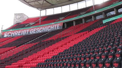 "04 July 2020, Berlin: Football: DFB Cup, Final: Bayer Leverkusen - FC Bayern Munich in the Olympic Stadium. T-shirts with the inscription ""Finale"" are put over the seats on the empty grandstand - in the background hangs a banner with the inscription ""Writes history"". Photo: Michael Sohn\/AP Pool\/dpa - IMPORTANT NOTE: In accordance with the regulations of the DFL Deutsche Fußball Liga and the DFB Deutscher Fußball-Bund, it is prohibited to exploit or have exploited in the stadium and\/or from the game taken photographs in the form of sequence images and\/or video-like photo series"