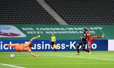 04 July 2020, Berlin: Football: DFB Cup, Final: Bayer Leverkusen - FC Bayern Munich, in the Olympic Stadium. Munich\'s Serge Gnabry (r) scores the second goal of his team. Photo: Annegret Hilse\/Reuters\/pool\/dpa - IMPORTANT NOTE: In accordance with the regulations of the DFL Deutsche Fußball Liga and the DFB Deutscher Fußball-Bund, it is prohibited to exploit or have exploited in the stadium and\/or from the game taken photographs in the form of sequence images and\/or video-like photo series