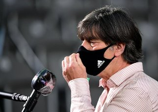 04 July 2020, Berlin: Football: DFB Cup, Final: Bayer Leverkusen - FC Bayern Munich in the Olympic Stadium. National coach Joachim Löw with a mouth guard during the interview. IMPORTANT NOTE: According to the regulations of the DFL Deutsche Fußball Liga and the DFB Deutscher Fußball-Bund, it is prohibited to use or have used in the stadium and\/or from the game taken photographs in the form of sequence pictures and\/or video-like photo series. Photo: Robert Michael\/dpa-Zentralbild\/Pool