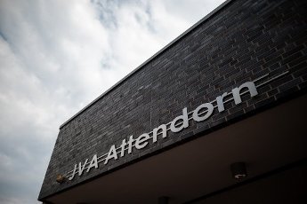 """12 August 2020, North Rhine-Westphalia, Attendorn: On the facade of a building of the Attendorn prison hangs the lettering """"JVA Attendorn"""". North Rhine-Westphalia\'s Justice Minister Biesenbach presents the current telemedicine pilot project in prisons. Thanks to digital technology, prisoners can access medical care outside office hours and within prison walls around the clock with live transmissions. Seven of the 36 prisons in NRW are taking part in the pilot project. Photo: Fabian Strauch\/dpa"""